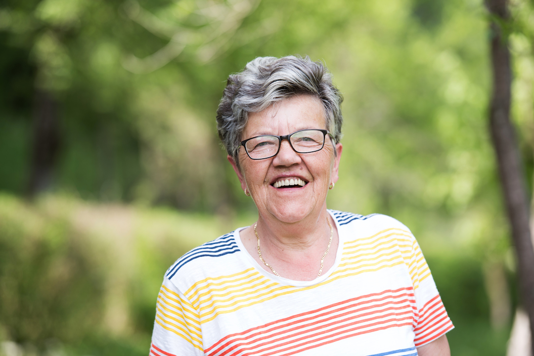 Smiling senior | Featured image for 'do dentures ever feel normal?'